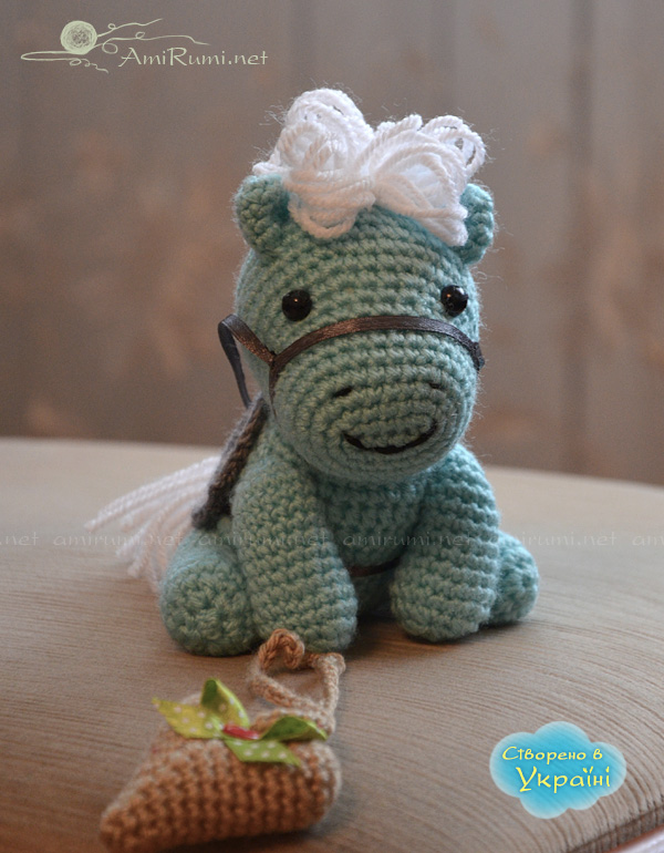 Crocheted amigurumi toy little horsie with heart