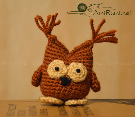 Crocheted amigurumi toy Inquisitive Owlet