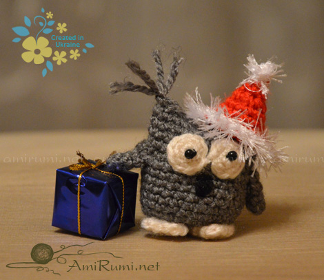 Crocheted amigurumi toy Christmas owlet