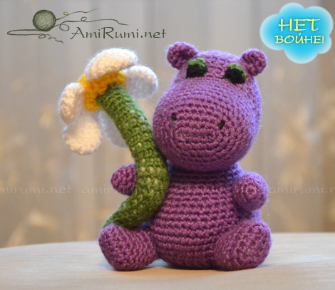 Crocheted amigurumi toy Hippo with Daisy