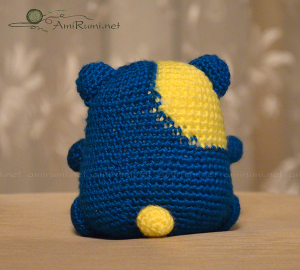 Crocheted amigurumi toy humster, back side
