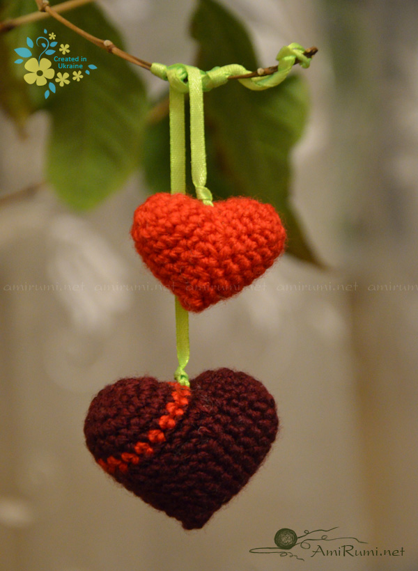 Crocheted red hearts hanging on ribbon